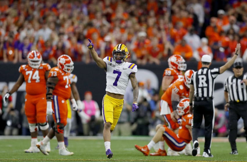 NEW ORLEANS, LOUISIANA - JANUARY 13: Grant Delpit #7 of the LSU Tigers reacts after sacking Trevor Lawrence #16 of the Clemson Tigers during the first quarter in the College Football Playoff National Championship game at Mercedes Benz Superdome on January 13, 2020 in New Orleans, Louisiana. (Photo by Jonathan Bachman/Getty Images)