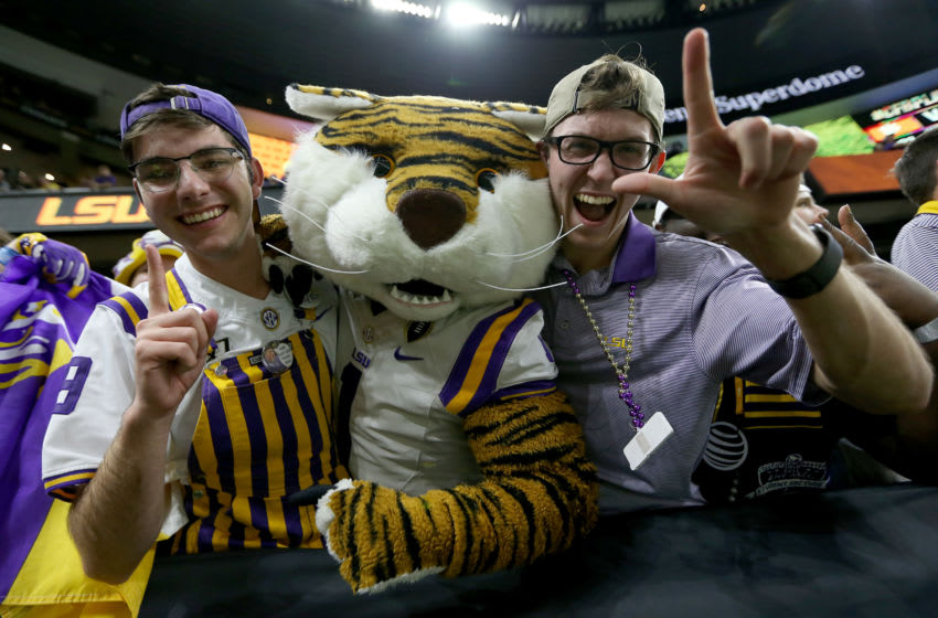 NEW ORLEANS, LOUISIANA - JANUARY 13: LSU Tigers fans cheer during the third quarter against Clemson Tigers in the College Football Playoff National Championship game at Mercedes Benz Superdome on January 13, 2020 in New Orleans, Louisiana. (Photo by Jonathan Bachman/Getty Images)