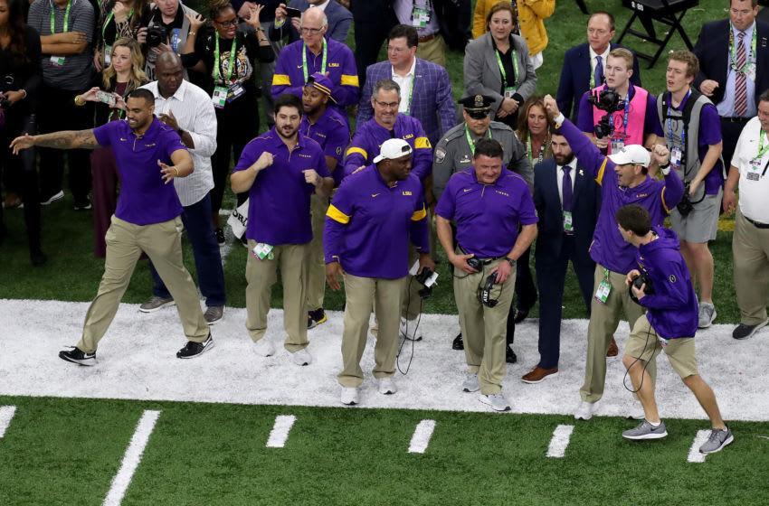 LSU football's coaching staff celebrating (Photo by Sean Gardner/Getty Images)