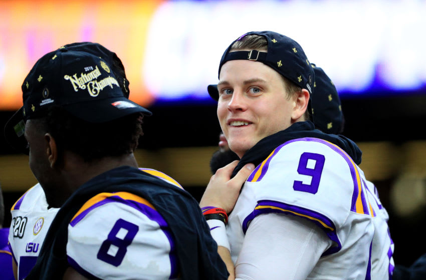 NEW ORLEANS, LOUISIANA - JANUARY 13: Joe Burrow #9 of the LSU Tigers celebrates after defeating the Clemson Tigers 42-25 in the College Football Playoff National Championship game at Mercedes Benz Superdome on January 13, 2020 in New Orleans, Louisiana. (Photo by Mike Ehrmann/Getty Images)