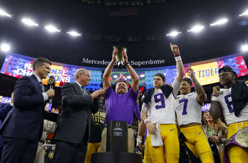 NEW ORLEANS, LOUISIANA - JANUARY 13: Joe Burrow #9 of the LSU Tigers celebrates with head coach Ed Orgeron of the LSU Tigers after defeating the Clemson Tigers 42-25 in the College Football Playoff National Championship game at Mercedes Benz Superdome on January 13, 2020 in New Orleans, Louisiana. (Photo by Kevin C. Cox/Getty Images)