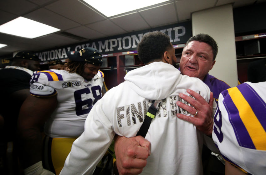 NEW ORLEANS, LOUISIANA - JANUARY 13: Head coach Ed Orgeron of the LSU Tigers hugs Odell Beckham Jr. in the locker room after their 42-25 win over Clemson Tigers in the College Football Playoff National Championship game at Mercedes Benz Superdome on January 13, 2020 in New Orleans, Louisiana. (Photo by Chris Graythen/Getty Images)