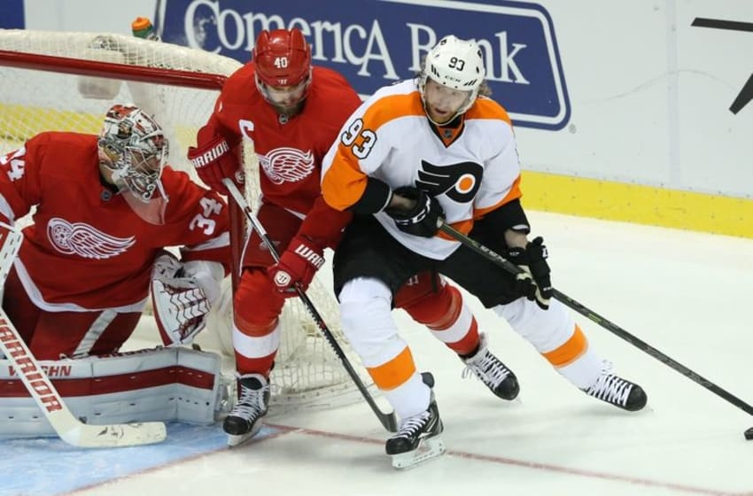Jan 17, 2016; Detroit, MI, USA; Philadelphia Flyers right wing Jakub Voracek (93) skates with the puck as Detroit Red Wings left wing Henrik Zetterberg (40) and goalie Petr Mrazek (34) defend during the third period of the game at Joe Louis Arena. The Flyers defeated the Wings 2-1. Mandatory Credit: Leon Halip-USA TODAY Sports