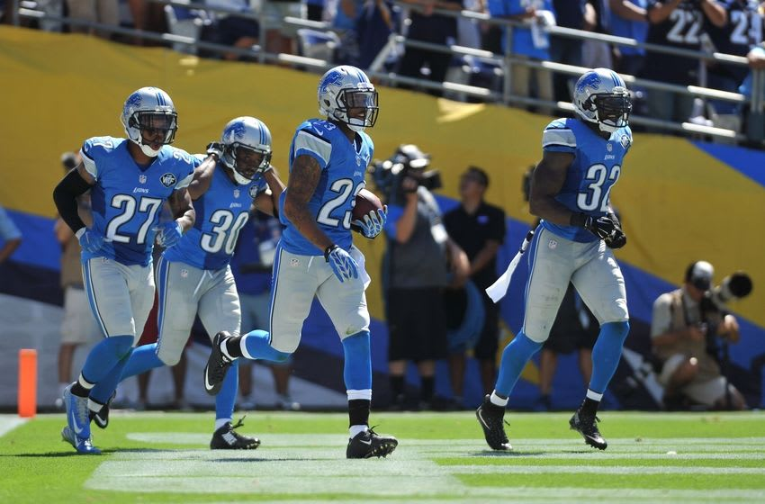 Sep 13, 2015; San Diego, CA, USA; Detroit Lions cornerback Darius Slay (23) runs back to the sideline after intercepting San Diego Chargers quarterback Philip Rivers (not pictured) along with free safety Glover Quin (27), defensive back Josh Wilson (30) and strong safety James Ihedigbo (32) during the second quarter at Qualcomm Stadium. San Diego won 33-28. Mandatory Credit: Orlando Ramirez-USA TODAY Sports