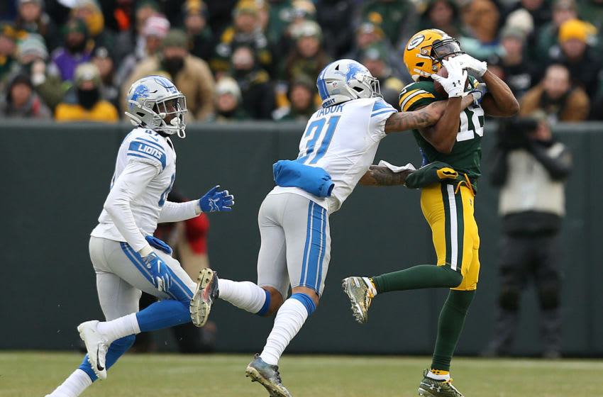 GREEN BAY, WISCONSIN - DECEMBER 30: Randall Cobb #18 of the Green Bay Packers catches a pass against Teez Tabor #31 of the Detroit Lions during the second half of a game at Lambeau Field on December 30, 2018 in Green Bay, Wisconsin. (Photo by Dylan Buell/Getty Images)