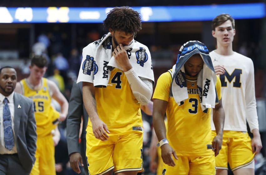 ANAHEIM, CALIFORNIA - MARCH 28: Isaiah Livers #4 and Zavier Simpson #3 of the Michigan Wolverines show their dejection after their loss to the Texas Tech Red Raiders during the 2019 NCAA Men's Basketball Tournament West Regional at Honda Center on March 28, 2019 in Anaheim, California. (Photo by Sean M. Haffey/Getty Images)