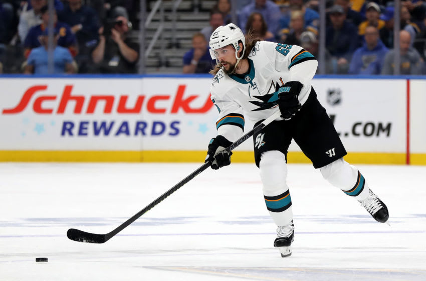 ST LOUIS, MISSOURI - MAY 15: Erik Karlsson #65 of the San Jose Sharks passes the puck against the St. Louis Blues during the first period in Game Three of the Western Conference Finals during the 2019 NHL Stanley Cup Playoffs at Enterprise Center on May 15, 2019 in St Louis, Missouri. (Photo by Elsa/Getty Images)