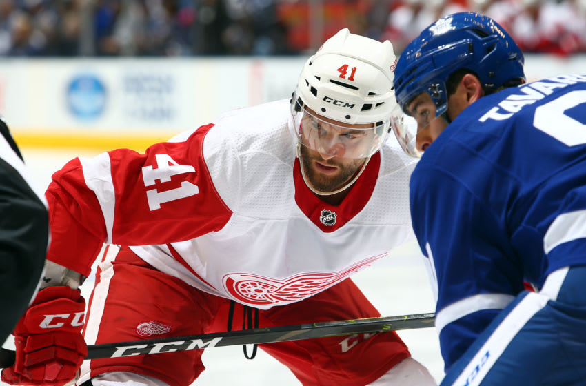 TORONTO, ON - SEPTEMBER 28: Luke Glendening #41 of the Detroit Red Wings faces off against John Tavares #91 of the Toronto Maple Leafs during an NHL pre-season game at Scotiabank Arena on September 28, 2019 in Toronto, Canada. (Photo by Vaughn Ridley/Getty Images)