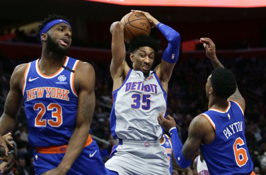DETROIT, MI - FEBRUARY 8: Christian Wood #35 of the Detroit Pistons grabs a rebound against Mitchell Robinson #23 and Elfrid Payton #6 of the New York Knicks during the first half at Little Caesars Arena on February 8, 2020, in Detroit, Michigan. NOTE TO USER: User expressly acknowledges and agrees that, by downloading and or using this photograph, User is consenting to the terms and conditions of the Getty Images License Agreement. (Photo by Duane Burleson/Getty Images)