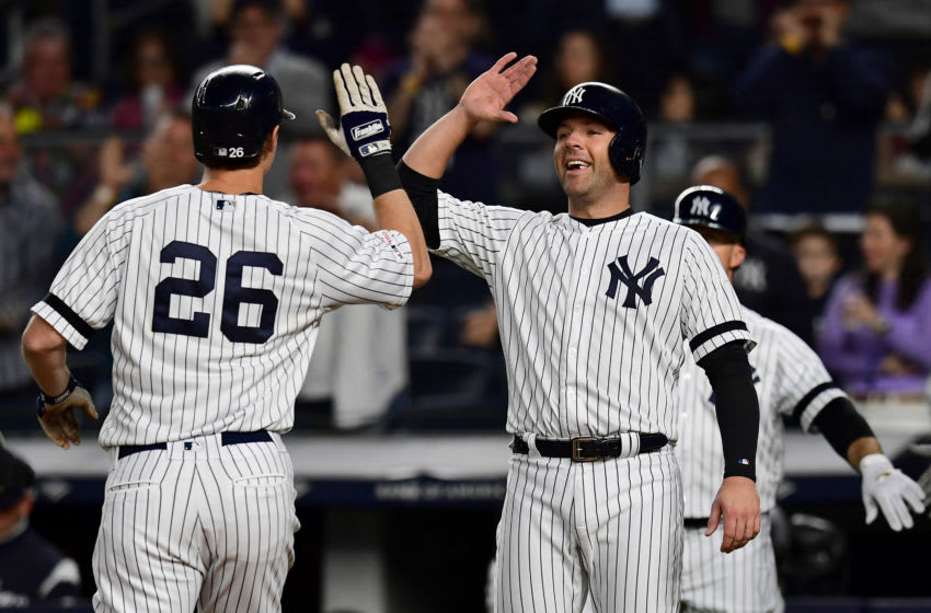 NEW YORK, NEW YORK - SEPTEMBER 19: DJ LeMahieu #26 of the New York Yankees high fives Austin Romine #28 of the New York Yankees after a three run home run in the second inning of their game against the Los Angeles Angels at Yankee Stadium on September 19, 2019 in the Bronx borough of New York City. (Photo by Emilee Chinn/Getty Images)
