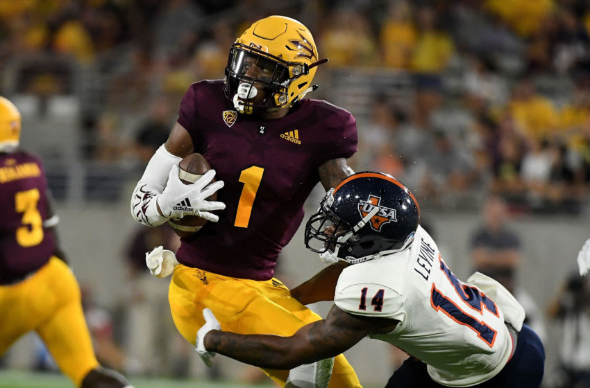 TEMPE, AZ - SEPTEMBER 01: Wide receiver N'Keal Harry #1 of the Arizona State Sun Devils breaks the tackle by safety C.J. Levine #14 of the UTSA Roadrunners to score a 58 yard touchdown in the first half at Sun Devil Stadium on September 1, 2018 in Tempe, Arizona. (Photo by Jennifer Stewart/Getty Images)