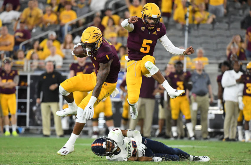 TEMPE, AZ - SEPTEMBER 01: Wide receiver N'Keal Harry #1 and quarterback Manny Wilkins #5 of the Arizona State Sun Devils jump over cornerback Clayton Johnson #29 of the UTSA Roadrunners in the second half at Sun Devil Stadium on September 1, 2018 in Tempe, Arizona. (Photo by Jennifer Stewart/Getty Images)