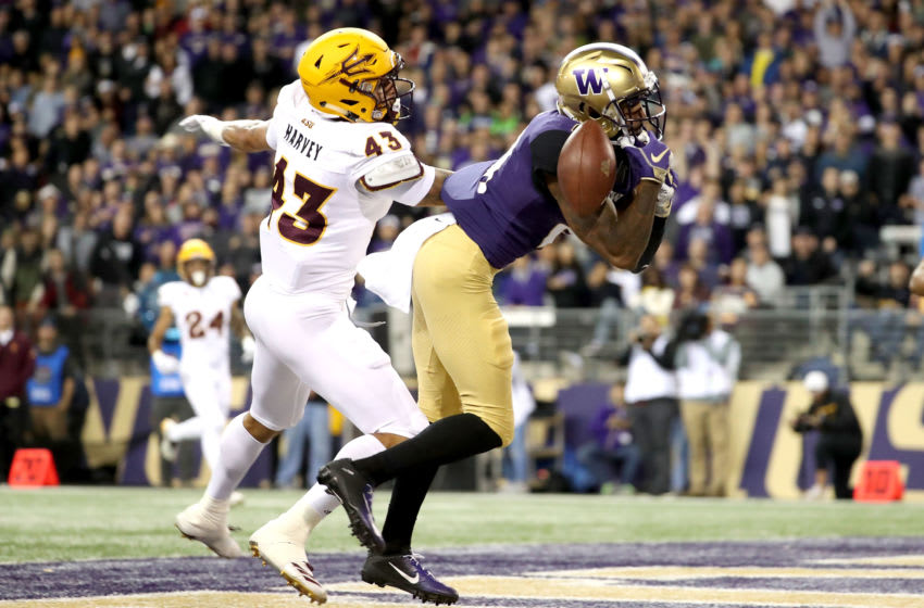 SEATTLE, WA - SEPTEMBER 22: Quinten Pounds #21 of the Washington Huskies drops what would have been a touchdown pass against Jalen Harvey #43 of the Arizona State Sun Devils in the second quarter during their game at Husky Stadium on September 22, 2018 in Seattle, Washington. (Photo by Abbie Parr/Getty Images)
