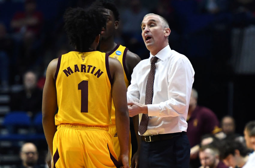 TULSA, OKLAHOMA - MARCH 22: Head coach Bobby Hurley of the Arizona State Sun Devils speaks to Remy Martin #1 during the first half of the first round game of the 2019 NCAA Men's Basketball Tournament against the Buffalo Bulls at BOK Center on March 22, 2019 in Tulsa, Oklahoma. (Photo by Stacy Revere/Getty Images)