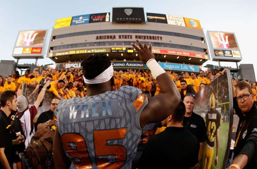 TEMPE, AZ - NOVEMBER 21: Defensive lineman Renell Wren #95 of the Arizona State Sun Devils celebrates as he walks off the field after defeating the Arizona Wildcats 52-37 in the college football game at Sun Devil Stadium on November 21, 2015 in Tempe, Arizona. (Photo by Christian Petersen/Getty Images)