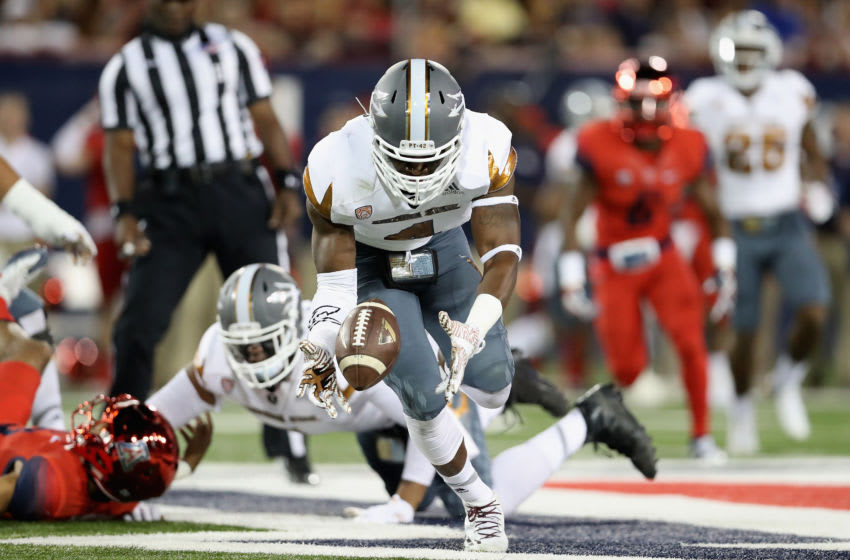 TUCSON, AZ - NOVEMBER 25: Defensive lineman Koron Crump #4 of the Arizona State Sun Devils recovers a fumble before scoring a 42 yard touchdown against the Arizona Wildcats during the first quarter of the Territorial Cup college football game at Arizona Stadium on November 25, 2016 in Tucson, Arizona. (Photo by Christian Petersen/Getty Images)