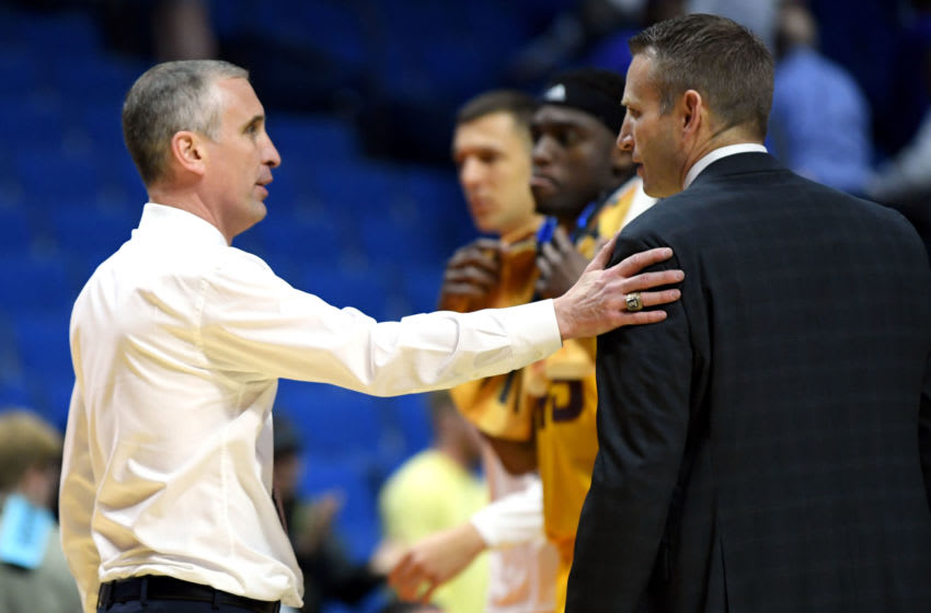 TULSA, OKLAHOMA - MARCH 22: Head coach Bobby Hurley of the Arizona State Sun Devils congratulates head coach Nate Oats of the Buffalo Bulls after their first round game of the 2019 NCAA Men's Basketball Tournament at BOK Center on March 22, 2019 in Tulsa, Oklahoma. The Bulls won the game 91-74. (Photo by Harry How/Getty Images)