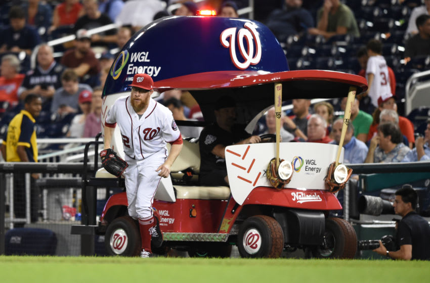 WASHINGTON, DC - SEPTEMBER 20: Sean Doolittle #62 of the Washington Nationals comes in the from the bullpen cart when comes in game in the ninth inning during a baseball game against the New York Mets at Nationals Park on September 20, 2018 in Washington, DC. (Photo by Mitchell Layton/Getty Images)