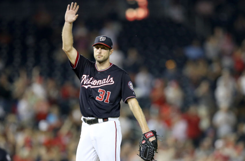 WASHINGTON, DC - SEPTEMBER 25: Starting pitcher Max Scherzer #31 of the Washington Nationals acknowledges the crowd after recording his 300th strikeout for the year against the Miami Marlins for the second out of the seventh inning at Nationals Park on September 25, 2018 in Washington, DC. (Photo by Rob Carr/Getty Images)