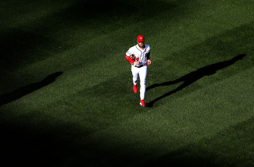 WASHINGTON, DC - SEPTEMBER 26: Bryce Harper #34 of the Washington Nationals jogs off the field during the end of the third inning against the Miami Marlins at Nationals Park on September 26, 2018 in Washington, DC. (Photo by Rob Carr/Getty Images)