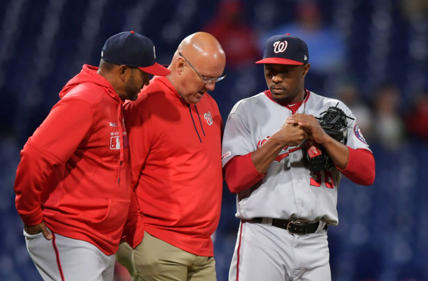 PHILADELPHIA, PA - APRIL 10: Manager Dave Martinez #4 and trainer Paul Lessard of the Washington Nationals talk to Tony Sipp #36 in the seventh inning against the Philadelphia Phillies Citizens Bank Park on April 10, 2019 in Philadelphia, Pennsylvania. (Photo by Drew Hallowell/Getty Images)