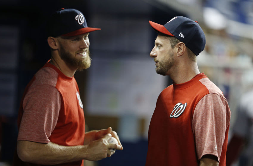 Max Scherzer #31 of the Washington Nationals talks with Stephen Strasburg #37 in the dugout against the Miami Marlins at Marlins Park on April 19, 2019 in Miami, Florida. (Photo by Michael Reaves/Getty Images)