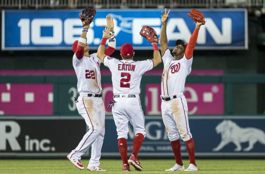 WASHINGTON, DC - JUNE 20: Juan Soto #22, Adam Eaton #2, and Victor Robles #16 of the Washington Nationals celebrate after the game against the Philadelphia Phillies at Nationals Park on June 20, 2019 in Washington, DC. (Photo by Scott Taetsch/Getty Images)