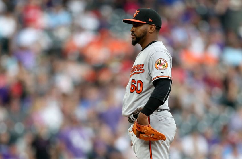 DENVER, COLORADO - MAY 26: Pitcher Mychal Givens #60 of the Baltimore Orioles throws in the ninth inning against the Colorado Rockies at Coors Field on May 26, 2019 in Denver, Colorado. (Photo by Matthew Stockman/Getty Images)
