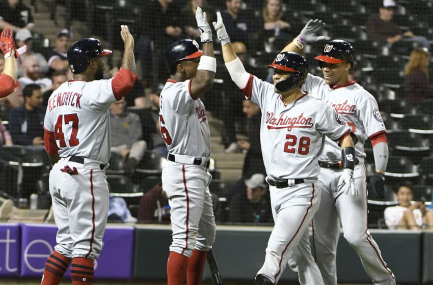 CHICAGO, ILLINOIS - JUNE 10: Kurt Suzuki #28 of the Washington Nationals is greeted after hitting a grand slam home run against the Chicago White Sox during the ninth inning at Guaranteed Rate Field on June 10, 2019 in Chicago, Illinois. (Photo by David Banks/Getty Images)