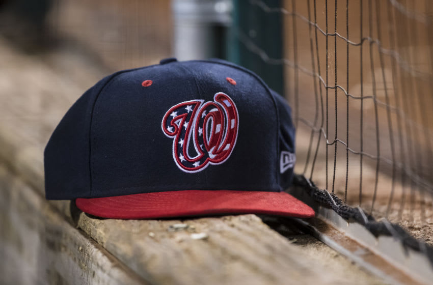 AUGUST 16: A Washington Nationals hat sits on the dugout wall during the eighth inning of the game between the Washington Nationals and the Milwaukee Brewers at Nationals Park on August 16, 2019 in Washington, DC. (Photo by Scott Taetsch/Getty Images)