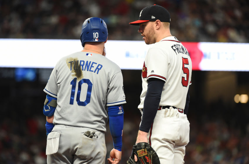 ATLANTA, GEORGIA - AUGUST 17: Freddie Freeman #5 of the Atlanta Braves talks to Justin Turner #10 of the Los Angeles Dodgers at SunTrust Park on August 17, 2019 in Atlanta, Georgia. (Photo by Logan Riely/Getty Images)