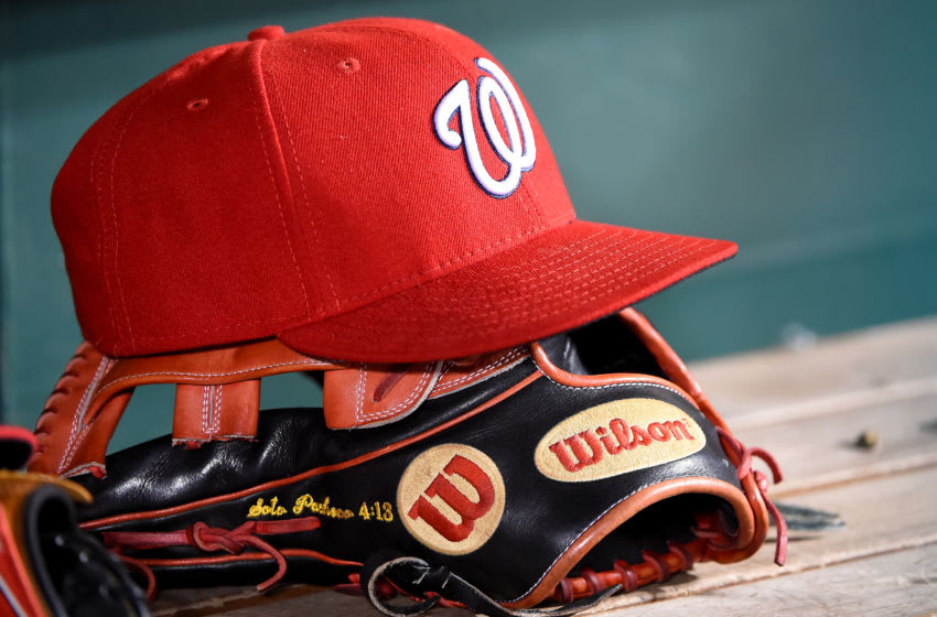 WASHINGTON, DC - SEPTEMBER 25: A general view of a Washington Nationals baseball hat on top of a Wilson baseball glove during the game against the Philadelphia Phillies at Nationals Park on September 25, 2019 in Washington, DC. (Photo by Will Newton/Getty Images)