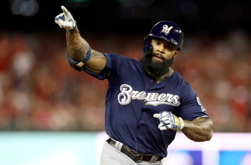 WASHINGTON, DC - OCTOBER 01: Eric Thames #7 of the Milwaukee Brewers celebrates after scoring a home run against Max Scherzer #31 of the Washington Nationals during the second inning in the National League Wild Card game at Nationals Park on October 01, 2019 in Washington, DC. (Photo by Rob Carr/Getty Images)