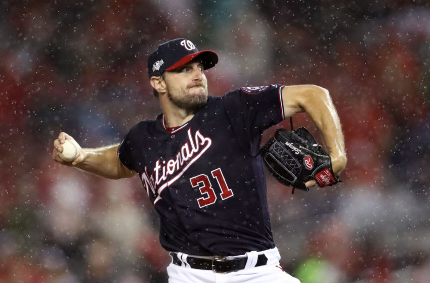 WASHINGTON, DC - OCTOBER 07: Max Scherzer #31 of the Washington Nationals delivers in the rain during the seventh inning of game four of the National League Division Series against the Los Angeles Dodgers at Nationals Park on October 07, 2019 in Washington, DC. (Photo by Rob Carr/Getty Images)