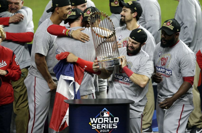 HOUSTON, TEXAS - OCTOBER 30: Adam Eaton #2 of the Washington Nationals holds the Commissioners Trophy after defeating the Houston Astros 6-2 in Game Seven to win the 2019 World Series in Game Seven of the 2019 World Series at Minute Maid Park on October 30, 2019 in Houston, Texas. (Photo by Bob Levey/Getty Images)