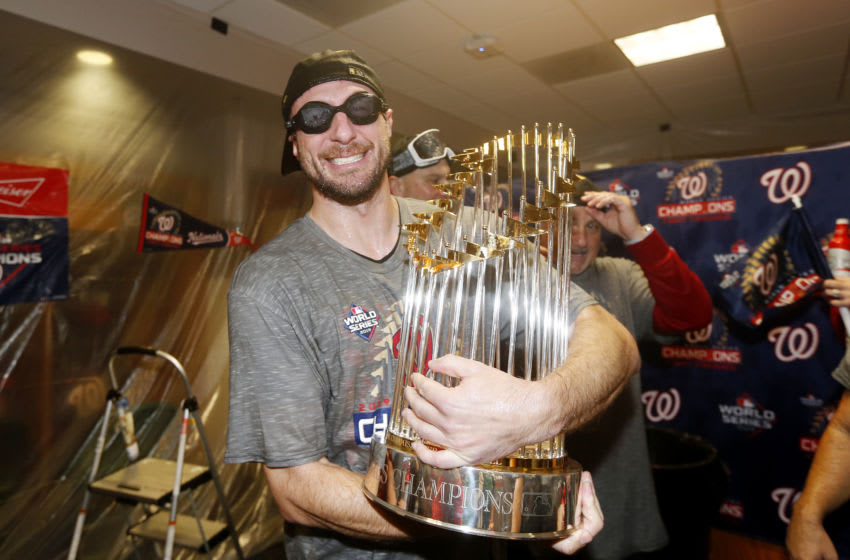 Max Scherzer #31 of the Washington Nationals celebrates in the locker room after defeating the Houston Astros in Game Seven to win the 2019 World Series at Minute Maid Park on October 30, 2019 in Houston, Texas. The Washington Nationals defeated the Houston Astros with a score of 6 to 2. (Photo by Elsa/Getty Images)