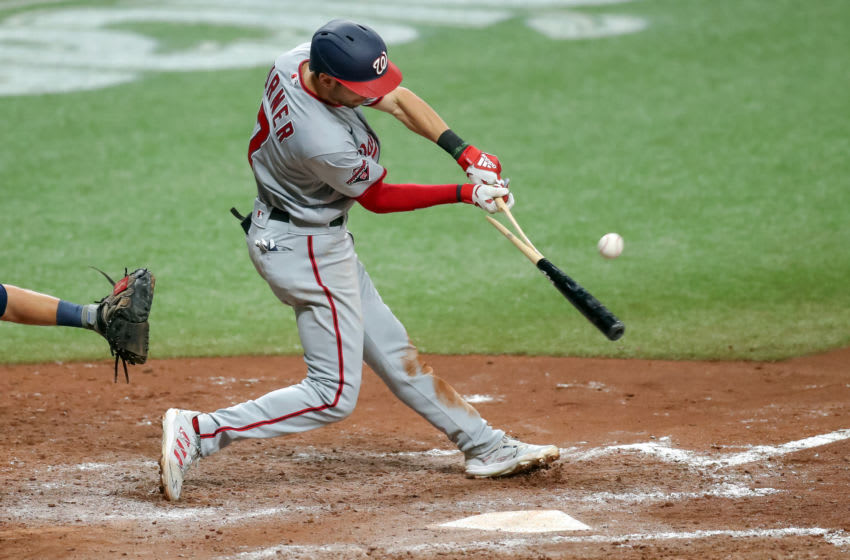 Trea Turner #7 of the Washington Nationals breaks his bat on a fly ball against the Tampa Bay Rays in the eighth inning of a baseball game at Tropicana Field on September 15, 2020 in St. Petersburg, Florida. (Photo by Mike Carlson/Getty Images)