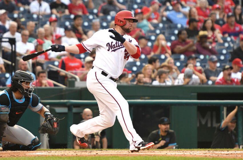 Jon Lester #34 of the Washington Nationals hits a single in the second inning during a baseball game against the Miami Marlins at Nationals Park on July 19, 2021 in Washington, DC. (Photo by Mitchell Layton/Getty Images)
