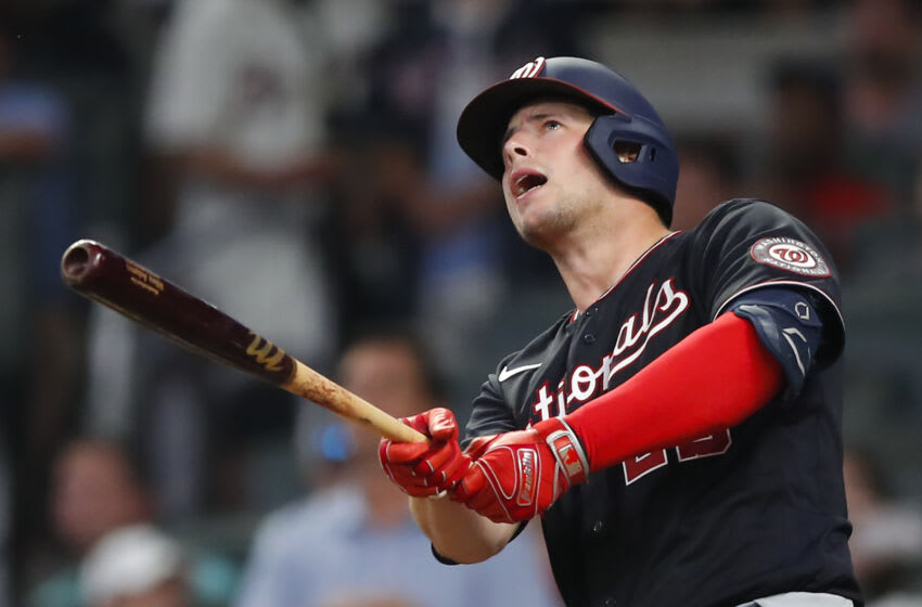 Riley Adams #25 of the Washington Nationals hits a go-ahead two-run home run in the ninth inning of an MLB game against the Atlanta Braves at Truist Park on August 7, 2021 in Atlanta, Georgia. (Photo by Todd Kirkland/Getty Images)