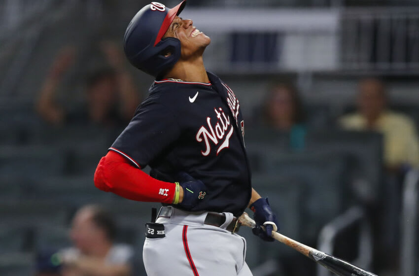 Juan Soto #22 of the Washington Nationals reacts after being hit by a pitch in the ninth inning of an MLB game against the Atlanta Braves at Truist Park on September 7, 2021 in Atlanta, Georgia. (Photo by Todd Kirkland/Getty Images)