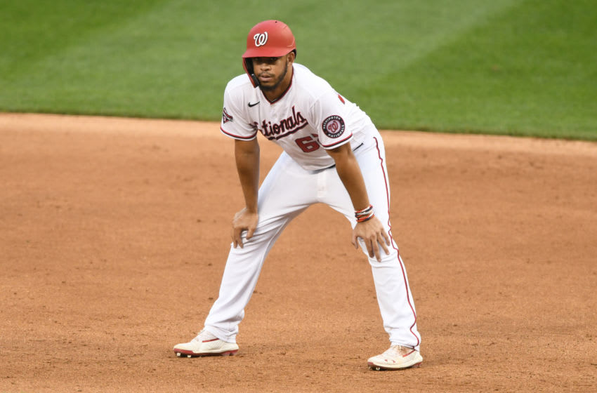 Luis Garcia #62 of the Washington Nationals leads off first base during a baseball game against the New York Mets at Nationals Park on September 27, 2020 in Washington, DC. (Photo by Mitchell Layton/Getty Images)