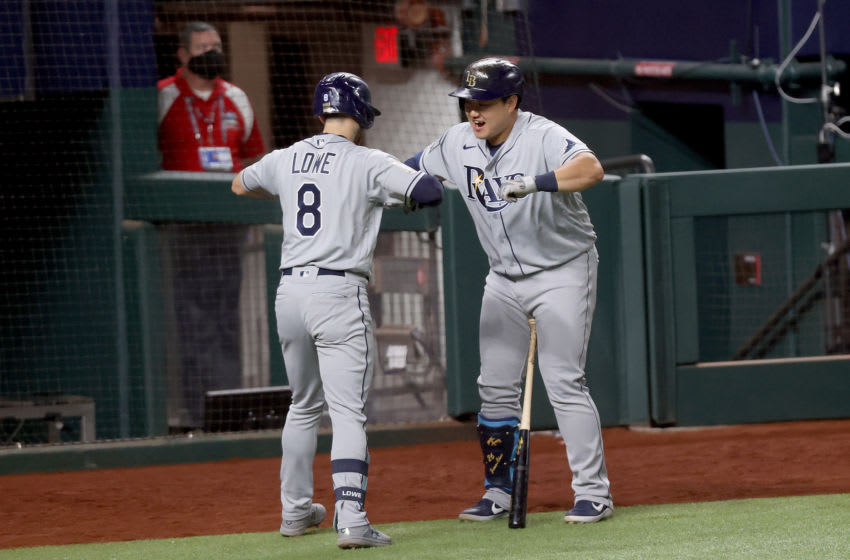 ARLINGTON, TEXAS - OCTOBER 21: Brandon Lowe #8 of the Tampa Bay Rays is congratulated by Ji-Man Choi after hitting a two run home run against the Los Angeles Dodgers during the fifth inning in Game Two of the 2020 MLB World Series at Globe Life Field on October 21, 2020 in Arlington, Texas. (Photo by Tom Pennington/Getty Images)