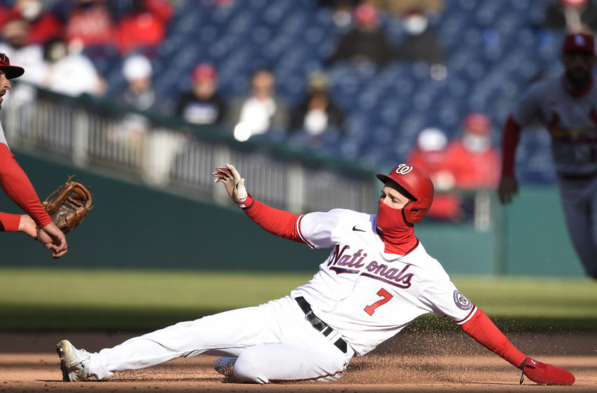 Trea Turner #7 of the Washington Nationals steals second base against Paul DeJong #11 of the St. Louis Cardinals in the sixth inning at Nationals Park on April 21, 2021 in Washington, DC. (Photo by Patrick McDermott/Getty Images)