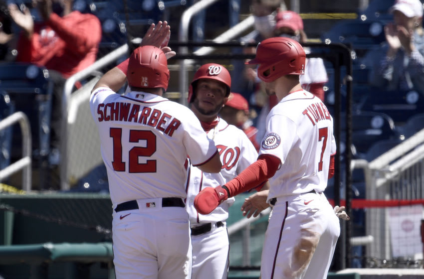 Kyle Schwarber #12, Trea Turner #7 and Yadiel Hernandez #29 of the Washington Nationals celebrate after scoring in the fourth inning against the Miami Marlins at Nationals Park on May 01, 2021 in Washington, DC. (Photo by Greg Fiume/Getty Images)