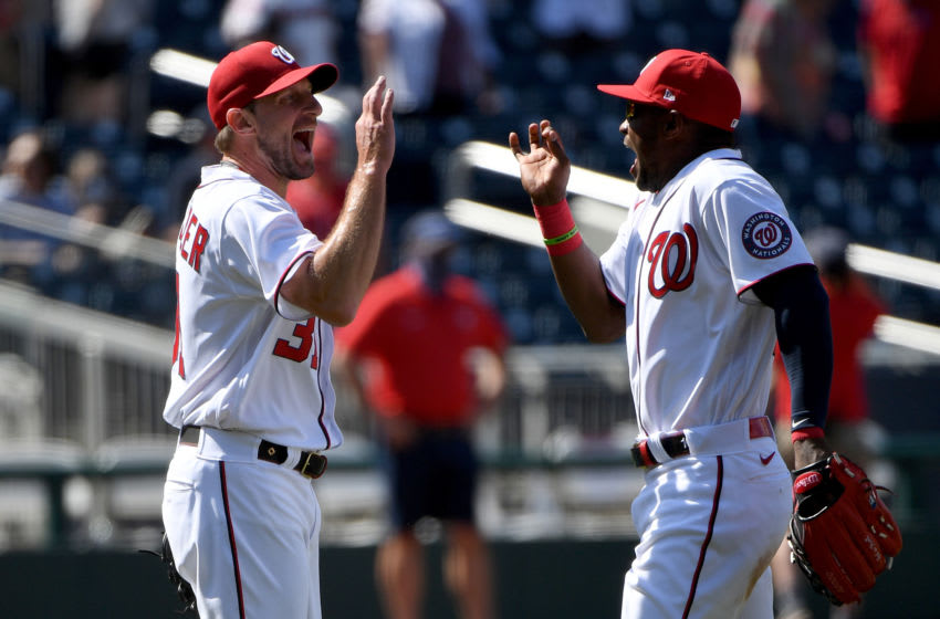 Max Scherzer #31 of the Washington Nationals celebrates with Victor Robles #16 after throwing a complete game against the Miami Marlins at Nationals Park on May 02, 2021 in Washington, DC. (Photo by Will Newton/Getty Images)