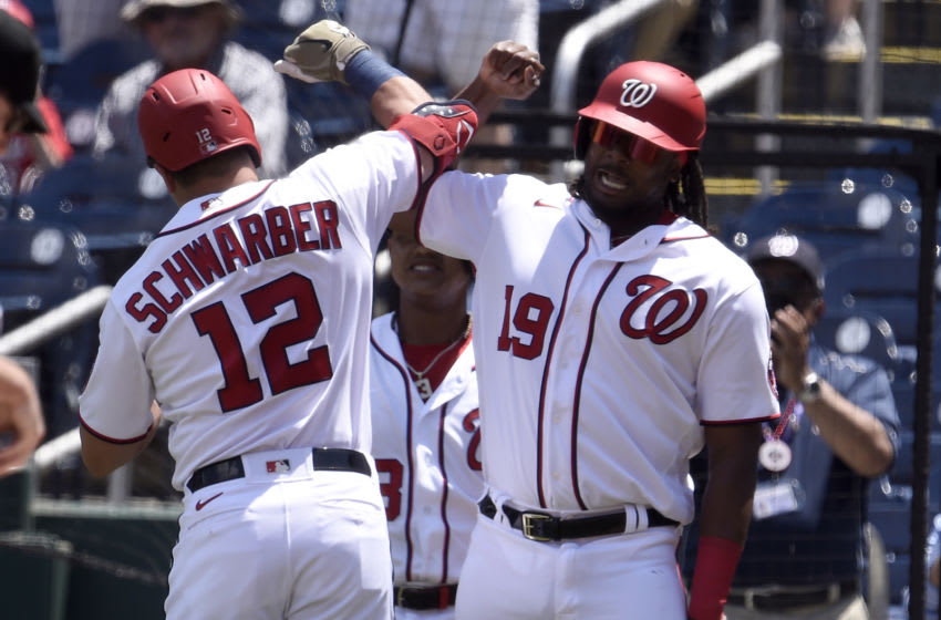 WASHINGTON, DC - MAY 23: Kyle Schwarber #12 of the Washington Nationals celebrates with Josh Bell #19 after hitting a two-run home run in the first inning against the Baltimore Orioles at Nationals Park on May 23, 2021 in Washington, DC. (Photo by Greg Fiume/Getty Images)