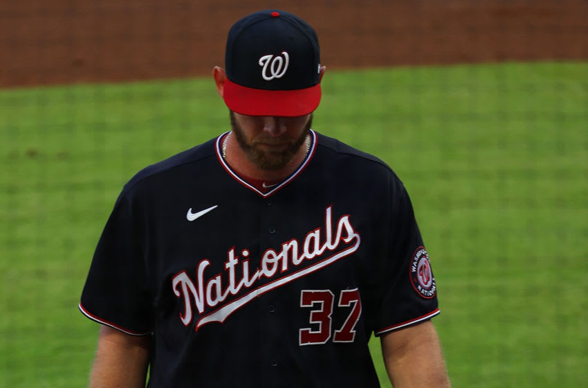 Stephen Strasburg #37 of the Washington Nationals walks off the field as he is replaced in the second inning after making a play on a line drive by William Contreras #24 of the Atlanta Braves at Truist Park on June 01, 2021 in Atlanta, Georgia. (Photo by Kevin C. Cox/Getty Images)
