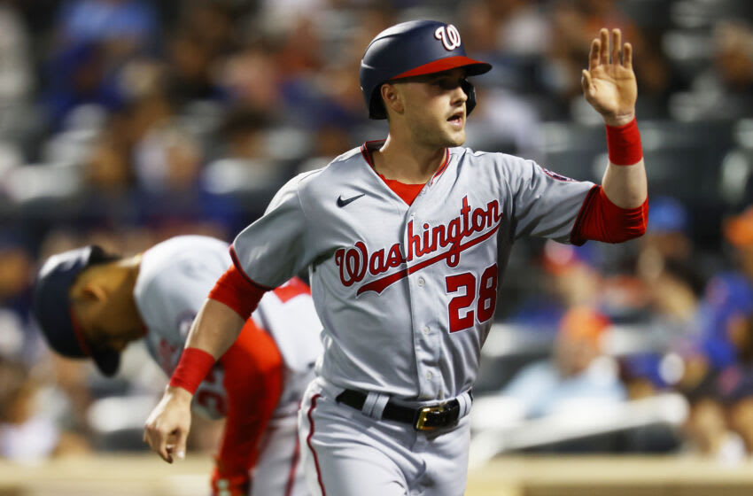 NEW YORK, NEW YORK - AUGUST 28: Lane Thomas #28 of the Washington Nationals celebrates after scoring on Alcides Escobar #3 single in the first inning against the New York Mets at Citi Field on August 28, 2021 in New York City. (Photo by Mike Stobe/Getty Images)