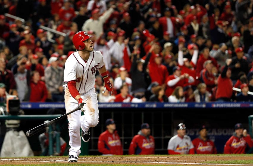 WASHINGTON, DC - OCTOBER 12: Bryce Harper #34 of the Washington Nationals hits a home run in the third inning against the St. Louis Cardinals in Game Five of the National League Division Series at Nationals Park on October 12, 2012 in Washington, DC. (Photo by Rob Carr/Getty Images)