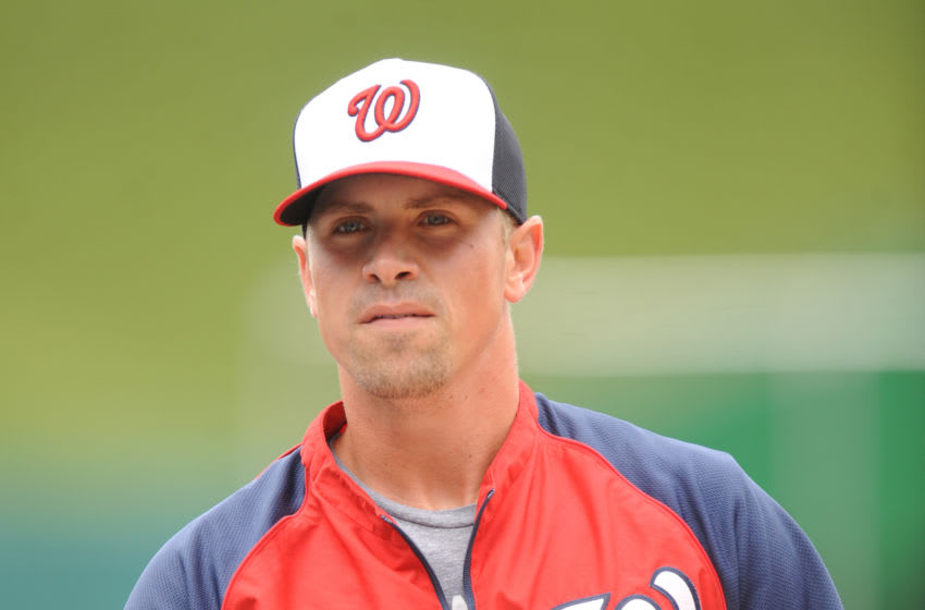 Tyler Moore #12 of the Washington Nationals looks on during batting practice of a baseball game against the Atlanta Braves on September 10, 2014 at Nationals Park in Washington, DC. The Braves won 6 to 2. (Photo by Mitchell Layton/Getty Images)